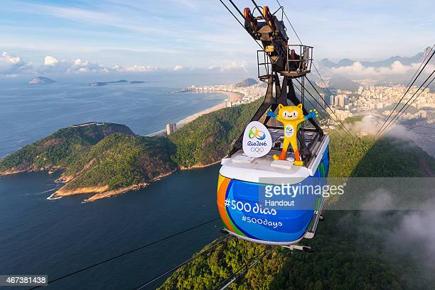 In this handout image provided by Rio 2016 Olympic mascot Vinicius rides from the top of the Sugarloaf cable on March 23 2015 in Rio De Janeiro...