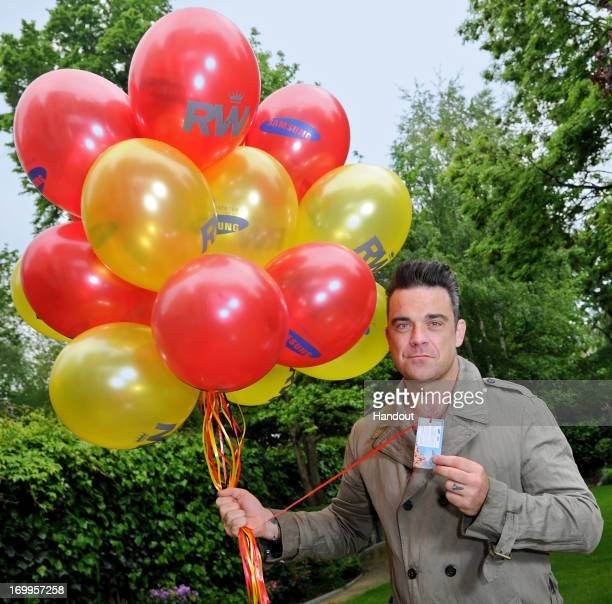 In this handout image provided by Samsung Robbie Williams and Samsung get set to celebrate his upcoming Take The Crown Stadium Tour 2013 which starts...