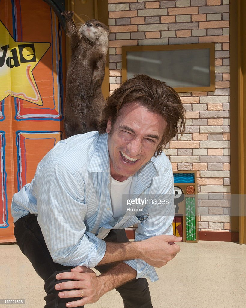 In this handout image provided by SeaWorld San Diego, actor <a gi-track='captionPersonalityLinkClicked' href=/galleries/search?phrase=Dermot+Mulroney&family=editorial&specificpeople=208776 ng-click='$event.stopPropagation()'>Dermot Mulroney</a> is all smiles as he gives O.P. Otter a boost during his visit to SeaWorld San Diego on April 1, 2013 in San Diego, California. Mulroney and his family also met several of the marine park's other ambassador animals including penguins, dolphins and sharks.