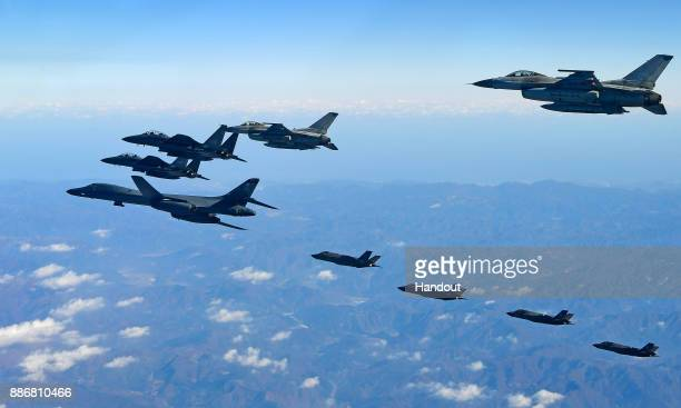 In this handout image provided by South Korean Defense Ministry US Air Force B1B bomber South Korea and US fighter jets fly over the Korean Peninsula...