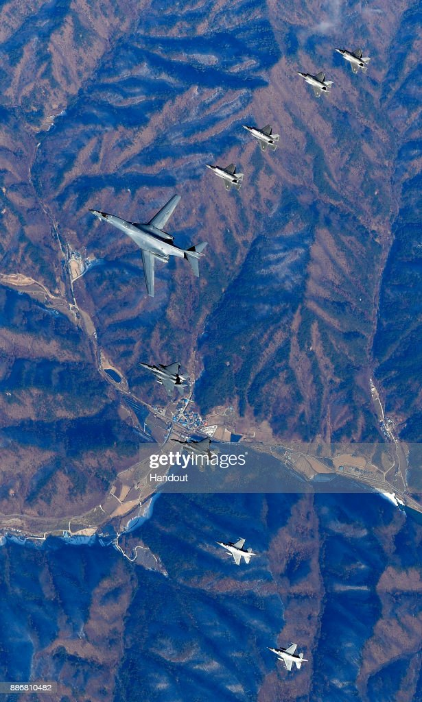 In this handout image provided by South Korean Defense Ministry, U.S. Air Force B-1B bomber (C), South Korea and U.S. fighter jets fly over the Korean Peninsula during the Vigilant air combat exercise (ACE) on December 6, 2017 in Korean Peninsula, South Korea. The largest-scale warplanes and military personnel take part in the annual joint exercise, which was scheduled before the North's latest missile test. North Korea fired a new intercontinental ballistic missile (ICBM) on November 29, believed to have shown capability to reach to the U.S. mainland.