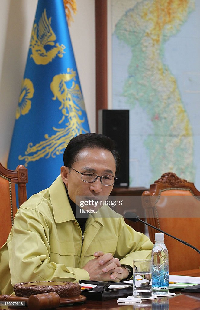 In this handout image provided by South Korean Presidential Palace, South President Lee Myung-Bak presides over an emergency Cabinet meeting at the presidential office to discuss national security issues arising from the reported death of North Korean leader Kim Jong-Il on December 19, 2011 in Seoul, South Korea. State television today announced Kim Jon Il, aged 69, died Saturday after reportedly suffering a heart attack. Reports claim mourners will be permitted to view the body between December 20 - 27, with a state funeral to be held on December 28. Kim-Jong Il will be succeeded by his third son, Kim Jon Un.