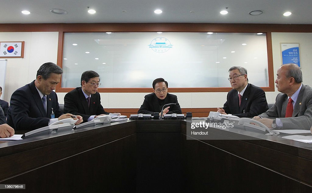 In this handout image provided by South Korean Presidential Palace, South President Lee Myung-Bak (C), Defense Minister Kim Kwan-Jin (L), Prime Minister Kim Hwang-Shik (2nd L) and Foreign Minister Kim Sung-Hwan (2nd R) attend an emergency Cabinet meeting at the presidential office to discuss national security issues arising from the reported death of North Korean leader Kim Jong-Il on December 19, 2011 in Seoul, South Korea. State television today announced Kim Jon Il, aged 69, died Saturday after reportedly suffering a heart attack. Reports claim mourners will be permitted to view the body between December 20 - 27, with a state funeral to be held on December 28. Kim-Jong Il will be succeeded by his third son, Kim Jong-Un.
