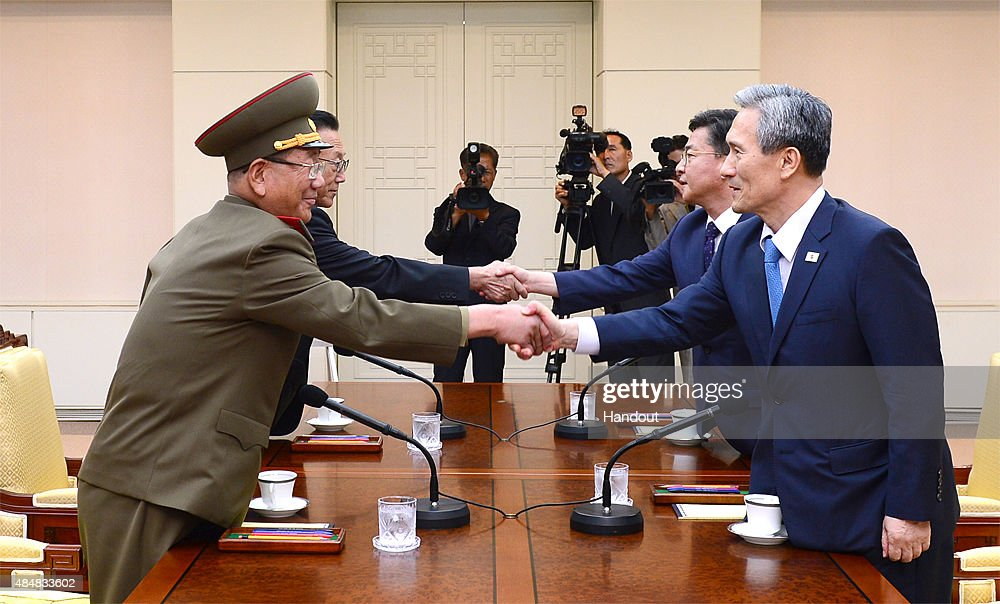 In this handout image provided by South Korean Unification Ministry, South Korean National Security Adviser Kim Kwan-Jin (R), South Korean Unification Minister Hong Yong-Pyo (2nd R), <a gi-track='captionPersonalityLinkClicked' href=/galleries/search?phrase=Kim+Yang-Gon&family=editorial&specificpeople=4679241 ng-click='$event.stopPropagation()'>Kim Yang-Gon</a> (2nd L), the top North Korean official in charge of inter-Korean affairs, and <a gi-track='captionPersonalityLinkClicked' href=/galleries/search?phrase=Hwang+Pyong-So&family=editorial&specificpeople=13629767 ng-click='$event.stopPropagation()'>Hwang Pyong-So</a> (L) the North Korean military's top political officer, shake hands during the inter-Korean high-level talks at the truce village of Panmunjom inside the Demilitarized Zone on August 22, 2015.
