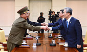 In this handout image provided by South Korean Unification Ministry South Korean National Security Adviser Kim KwanJin South Korean Unification...