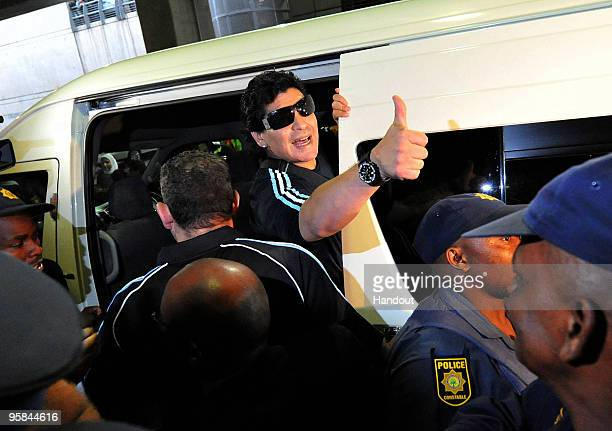In this handout image provided by the 2010 FIFA World Cup Organising Committee South Africa Argentina national soccer team manager Diego Maradona...