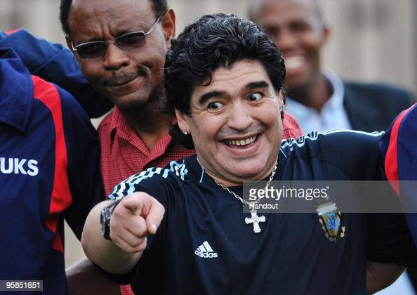 In this handout image provided by the 2010 FIFA World Cup Organising Committee South Africa Argentina head coach Diego Maradona attends a football...