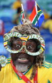 In this handout image provided by the 2010 FIFA World Cup Organising Committee for South Africa South African fans attend the International Friendly...