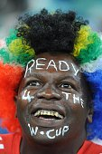 In this handout image provided by the 2010 FIFA World Cup Organising Committee for South Africa A South African fan attends the International...