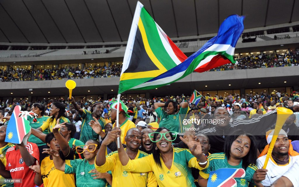 In this handout image provided by the 2010 FIFA World Cup Organising Committee South African fans show their support during the International...