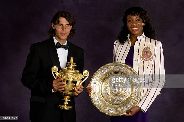 In this handout image provided by the AELTC Rafael Nadal of Spain the Winner of the Gentleman's Singles Tennis Wimbledon 2008 and Venus Williams of...