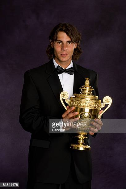 In this handout image provided by the AELTC Rafael Nadal of Spain the Winner of the Gentleman's Singles Tennis Wimbledon 2008 poses with the trophy...