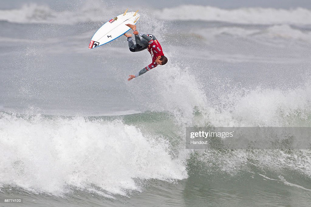 In this handout image provided by the Association of Surfing Professionals and Covered Images Damien Hobgood of the United States attempts a reverse...