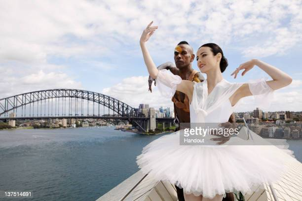 In this handout image provided by The Australian Ballet Principal Artist at The Australian Ballet Amber Scott and Bangarra Dance Theatre artist...