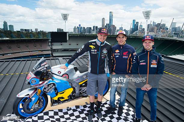 In this handout image provided by the Australian Grand Prix Corporation MotoGP riders Marc Marquez and Jack Miller and Moto3 rider Brad Binder pose...