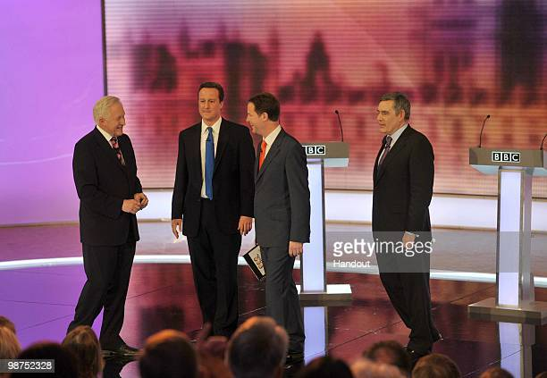In this handout image provided by the BBC Election debate moderator David Dimbleby stands beside Conservative Party leader David Cameron Liberal...