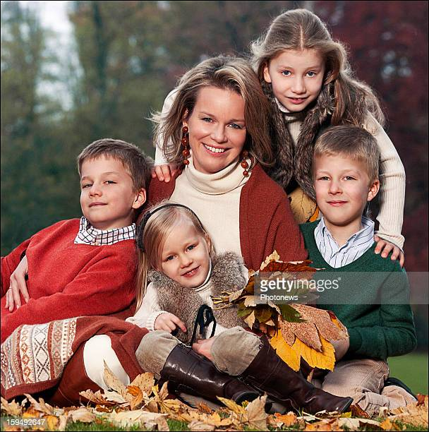 In this handout image provided by the Belgian Royal Palace Princess Mathilde of Belgium poses with her children Elisabeth Gabriel Emmanuel and...
