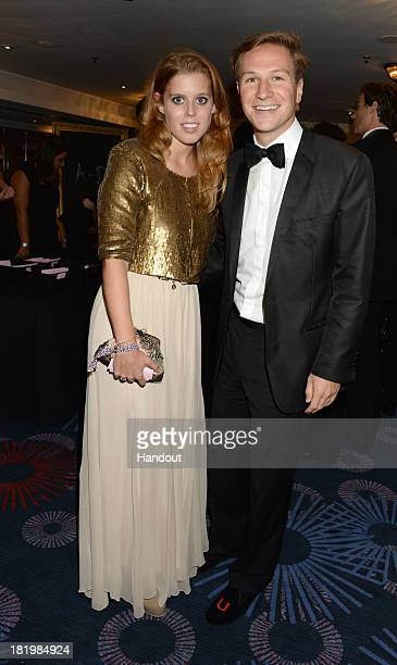 In this handout image provided by the Boodles Boxing Ball Committee Princess Beatrice of York and Dave Clark pose at the Boodles Boxing Ball 2013 on...