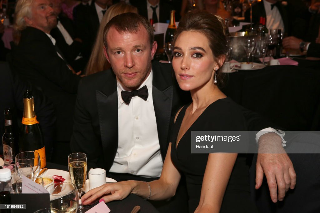 In this handout image provided by the Boodles Boxing Ball Committee, <a gi-track='captionPersonalityLinkClicked' href=/galleries/search?phrase=Guy+Ritchie&family=editorial&specificpeople=239519 ng-click='$event.stopPropagation()'>Guy Ritchie</a> and <a gi-track='captionPersonalityLinkClicked' href=/galleries/search?phrase=Jacqui+Ainsley&family=editorial&specificpeople=209223 ng-click='$event.stopPropagation()'>Jacqui Ainsley</a> pose at the Boodles Boxing Ball 2013 on September 21, 2013 at the Grosvenor House in London,England.