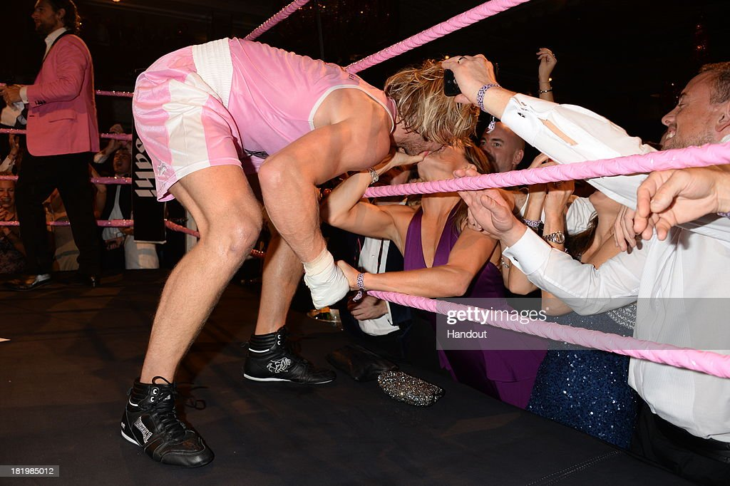 In this handout image provided by the Boodles Boxing Ball Committee, Owain Walbyoff kisses his wife Natalie Pinkhamat the Boodles Boxing Ball 2013 on September 21, 2013 at the Grosvenor House in London,England.