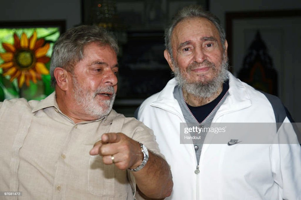 In this handout image provided by the Brazlian Presidency, First Secretary of the Communist Party of Cuba <a gi-track='captionPersonalityLinkClicked' href=/galleries/search?phrase=Fidel+Castro&family=editorial&specificpeople=67210 ng-click='$event.stopPropagation()'>Fidel Castro</a> (R) speaks with Brazil�s President <a gi-track='captionPersonalityLinkClicked' href=/galleries/search?phrase=Luiz+Inacio+Lula+da+Silva&family=editorial&specificpeople=211609 ng-click='$event.stopPropagation()'>Luiz Inacio Lula da Silva</a> (R) during a private meeting on February 24, 2010 in Havana, Cuba. Lula is on a two day visit to Cuba after having attended the Summit of the Group of Rio states in Mexico.