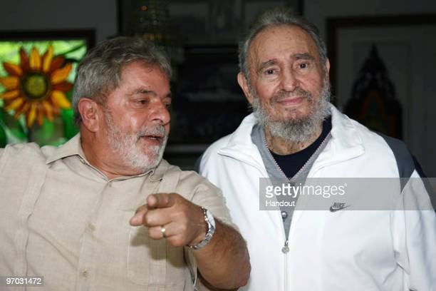 In this handout image provided by the Brazlian Presidency First Secretary of the Communist Party of Cuba Fidel Castro speaks with Brazil�s President...
