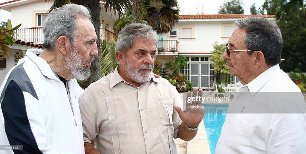 In this handout image provided by the Brazlian Presidency, First Secretary of the Communist Party of Cuba <a gi-track='captionPersonalityLinkClicked' href=/galleries/search?phrase=Fidel+Castro&family=editorial&specificpeople=67210 ng-click='$event.stopPropagation()'>Fidel Castro</a>, Brazil�s President <a gi-track='captionPersonalityLinkClicked' href=/galleries/search?phrase=Luiz+Inacio+Lula+da+Silva&family=editorial&specificpeople=211609 ng-click='$event.stopPropagation()'>Luiz Inacio Lula da Silva</a> (R) and Cuban Preisdent <a gi-track='captionPersonalityLinkClicked' href=/galleries/search?phrase=Raul+Castro&family=editorial&specificpeople=239452 ng-click='$event.stopPropagation()'>Raul Castro</a> speak during a private meeting on February 24, 2010 in Havana, Cuba. Lula is on a two day visit to Cuba after having attended the Summit of the Group of Rio states in Mexico.