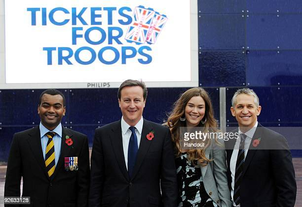 In this handout image provided by the Conservative Party Lance Corporal Johnson Beharry VC Leader of the Conservative Party David Cameron Joss Stone...