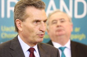 In this handout image provided by the Dept of the Taoiseach EU Energy Commissioner Guenther Oettinger addresses the media beside Minister for...