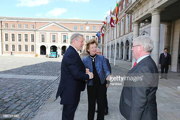 In this handout image provided by the Dept of the Taoiseach Former Vice President of the United States Al Gore is welcomed to Dublin Castle by Mary...
