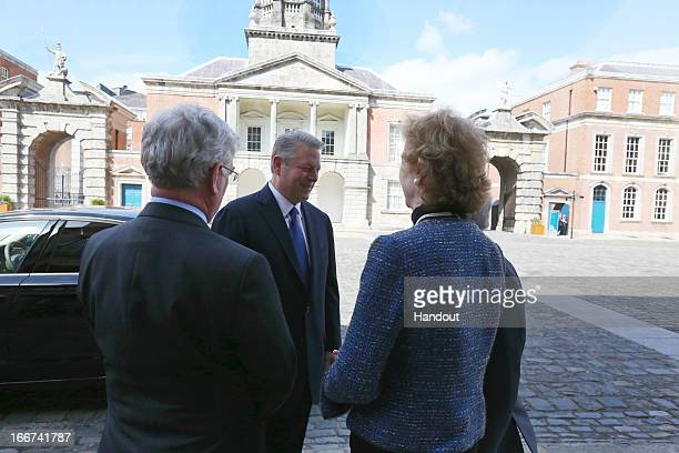 In this handout image provided by the Dept of the Taoiseach Former Vice President of the United States Al Gore is welcomed to Dublin Castle by Eamon...