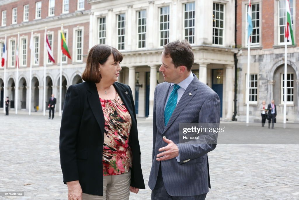 In this handout image provided by the Dept of the Taoiseach, Sean Sherlock TD Minister of State for Research and Innovation greets EU Commissioner <a gi-track='captionPersonalityLinkClicked' href=/galleries/search?phrase=Maire+Geoghegan-Quinn&family=editorial&specificpeople=6730937 ng-click='$event.stopPropagation()'>Maire Geoghegan-Quinn</a> during the two-day informal meeting of the Competitiveness Council on May 02, 2013 in Dublin, Ireland. The Council will meet in two configurations on Thursday and Friday under the overall theme 'Innovative Pathways to Jobs and Growth'.