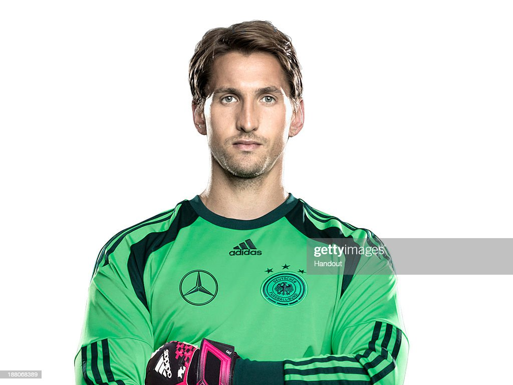 In this handout image provided by the DFB, goalkeeper <a gi-track='captionPersonalityLinkClicked' href=/galleries/search?phrase=Rene+Adler&family=editorial&specificpeople=686184 ng-click='$event.stopPropagation()'>Rene Adler</a> poses during the German National Team presentation on November 15, 2013 in Germany.