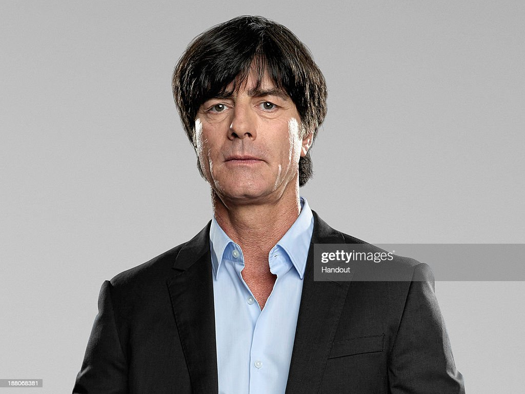 In this handout image provided by the DFB, head coach <a gi-track='captionPersonalityLinkClicked' href=/galleries/search?phrase=Joachim+Loew&family=editorial&specificpeople=215315 ng-click='$event.stopPropagation()'>Joachim Loew</a> poses during the German National Team presentation on November 15, 2013 in Germany.