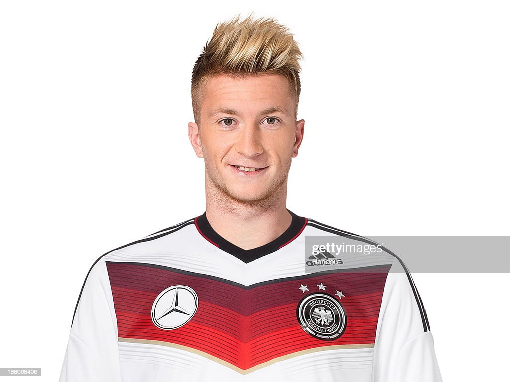 In this handout image provided by the DFB, <a gi-track='captionPersonalityLinkClicked' href=/galleries/search?phrase=Marco+Reus&family=editorial&specificpeople=5445884 ng-click='$event.stopPropagation()'>Marco Reus</a> poses during the German National Team presentation on November 15, 2013 in Germany.