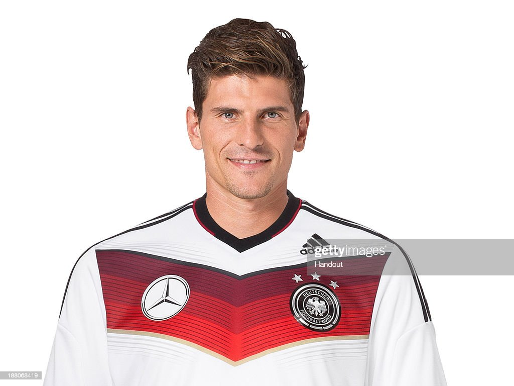 In this handout image provided by the DFB, <a gi-track='captionPersonalityLinkClicked' href=/galleries/search?phrase=Mario+Gomez+-+Voetballer&family=editorial&specificpeople=635161 ng-click='$event.stopPropagation()'>Mario Gomez</a> poses during the German National Team presentation on November 15, 2013 in Germany.