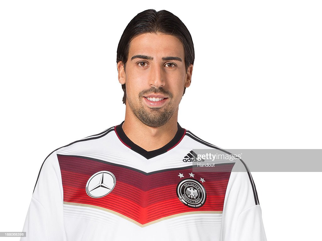 In this handout image provided by the DFB, <a gi-track='captionPersonalityLinkClicked' href=/galleries/search?phrase=Sami+Khedira&family=editorial&specificpeople=2513712 ng-click='$event.stopPropagation()'>Sami Khedira</a> poses during the German National Team presentation on November 15, 2013 in Germany.