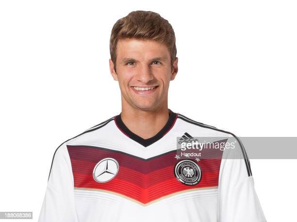 In this handout image provided by the DFB Thomas Mueller poses during the German National Team presentation on November 15 2013 in Germany