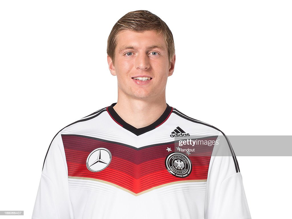 In this handout image provided by the DFB, <a gi-track='captionPersonalityLinkClicked' href=/galleries/search?phrase=Toni+Kroos&family=editorial&specificpeople=638597 ng-click='$event.stopPropagation()'>Toni Kroos</a> poses during the German National Team presentation on November 15, 2013 in Germany.