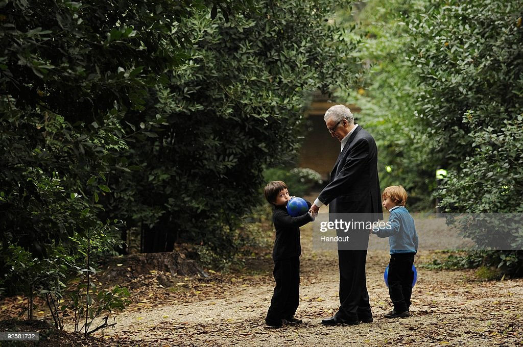In this handout image provided by the Elders, Lakhdar Brahimi walks with his grandsons Basile Brahimi, 3, and Balthazar Brahimi, 5, during a picnic event on October 31, 2009 in Istanbul, Turkey. Jimmy Carter, Desmond Tutu and their fellow Elders invited their grandchildren to join them this week to remind the world of the catastrophic risk of climate change to future generations. The seven Elders and their thirteen grandchildren from Asia, Africa, Europe and America met in Istanbul with the group ranging in age from 3 to 85.