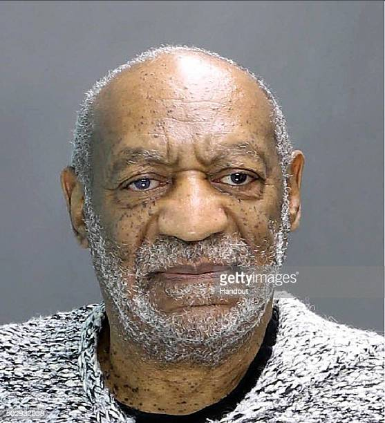 In this handout image provided by the Elkins Park Montgomery County District Attorney's office William H Cosby poses for a mugshot photo during his...