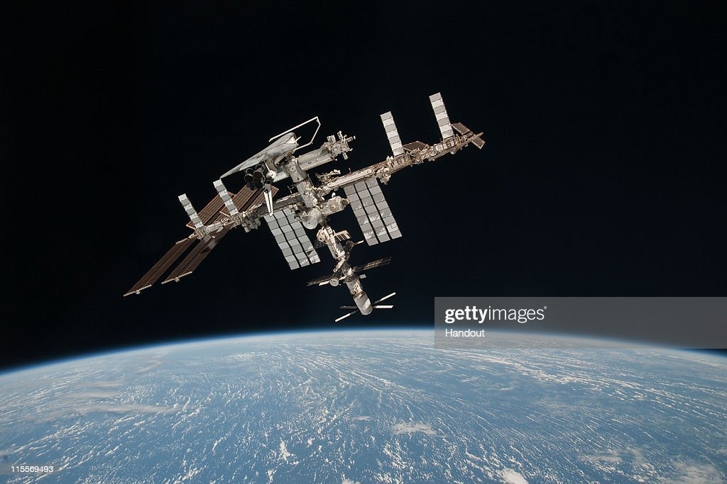 In this handout image provided by the European Space Agency and NASA the International Space Station and the docked space shuttle Endeavour orbit...