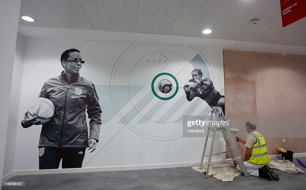 In this handout image provided by The FA, A photograph of England Women's Football manager Hope Powell is displayed in a hallway during a media event at the Football Association's new National Football Centre, St George's Park on July 10, 2012 in Burton, England.