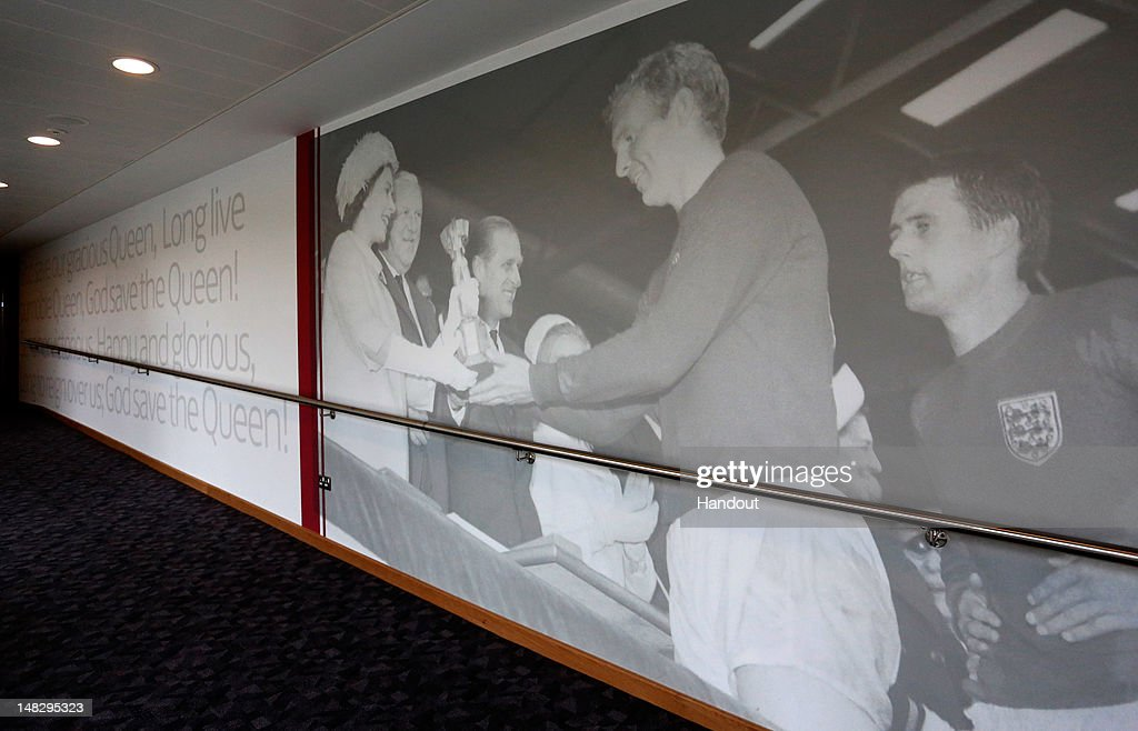 In this handout image provided by The FA, A photograph of former England captain Bobby Moore receiving the World Cup from the Queen is seen displayed on a hallway inside the Hampton by Hilton hotel during a media event at the Football Association's new National Football Centre, St George's Park on July 10, 2012 in Burton, England.