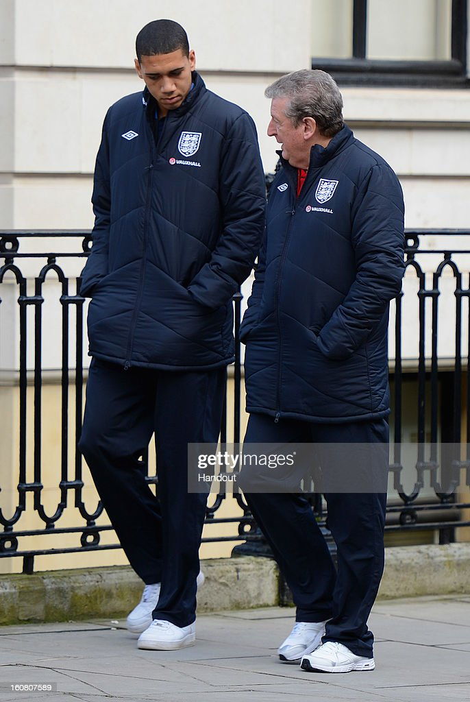In this handout image provided by The FA, Chris Smalling chats with manager Roy Hodgson as the England squad go for a walk around Mayfair in London ahead of the game against Brazil on February 6, 2013 in London England.