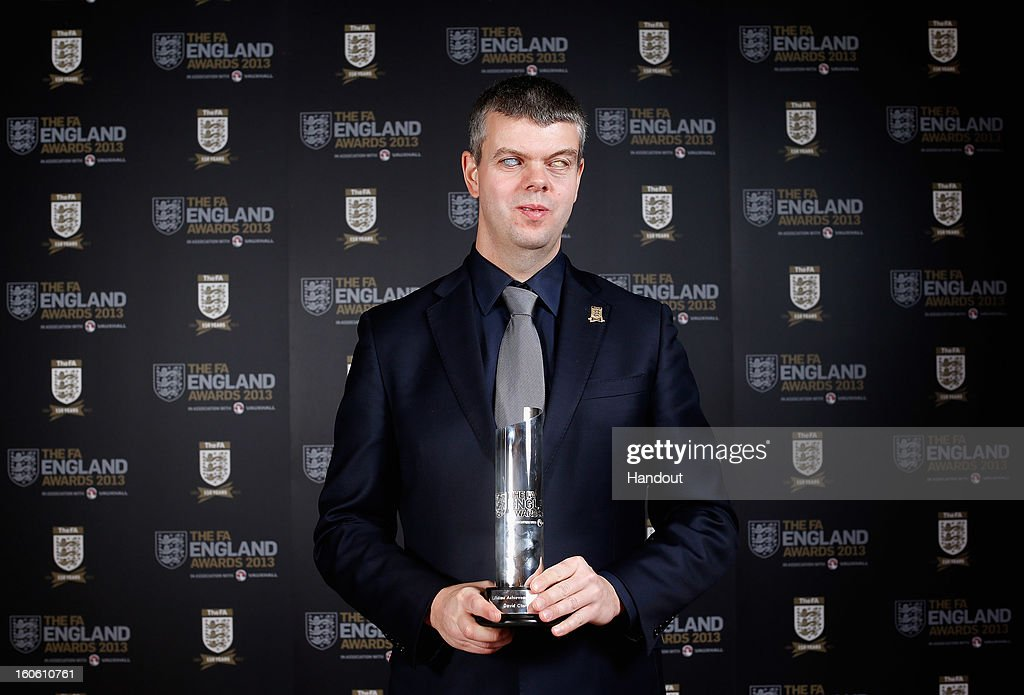 In this handout image provided by The FA, David Clarke of England and Team GB Blind team poses with his Lifetime Achievement award during the FA England Awards 2013 at St. George's Park on February 3, 2013 in Burton-upon-Trent, England.