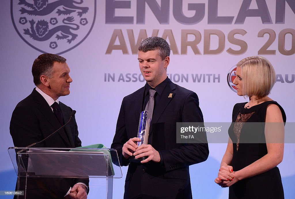 In this handout image provided by The FA, David Clarke of England and Team GB Blind team talks to presenters Ray Stubbs and Rebecca Lowe after receiving his Lifetime Achievement award during the FA England Awards 2013 at St. George's Park on February 3, 2013 in Burton-upon-Trent, England.
