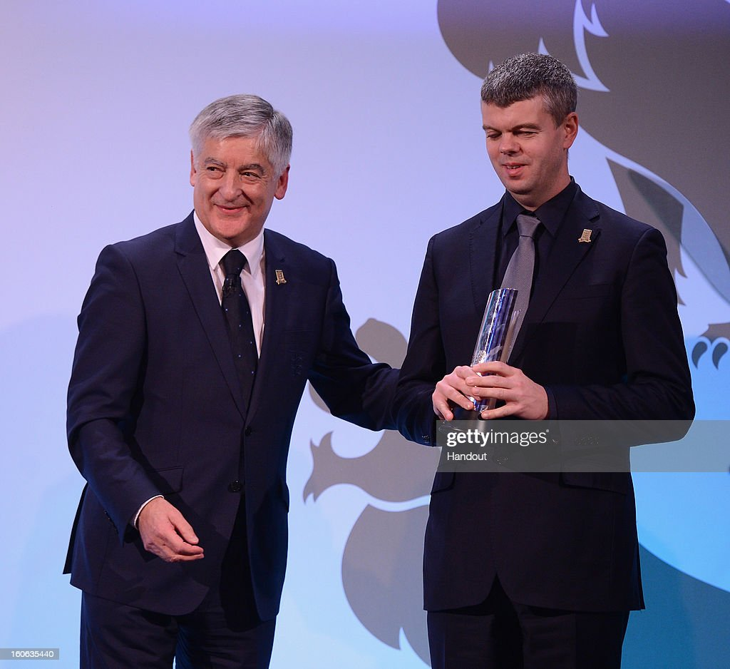 In this handout image provided by The FA, David Clarke of England and Team GB Blind team receives his Lifetime Achievement award from FA Chairman David Bernstein during the FA England Awards 2013 at St. George's Park on February 3, 2013 in Burton-upon-Trent, England.