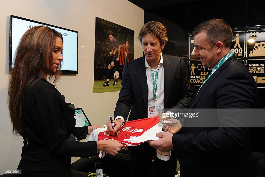 In this handout image provided by The FA, Edwin Van Der Sar autographs a football shirt in the FA150 lounge during the Soccerex European Forum Conference Programme in Manchester on April 10, 2013 in Manchester England.