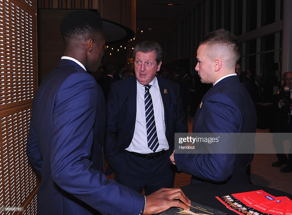 In this handout image provided by The FA, England manager Roy Hodgson talks to Danny Welbeck (L) and Tom Cleverley during the FA England Awards 2013 at St. George's Park on February 3, 2013 in Burton-upon-Trent, England.